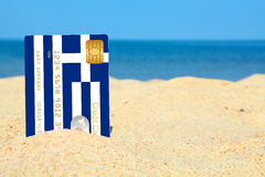Greek credit card on the beach Royalty Free Stock Photography
