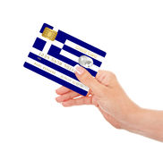 Greek credit card holded by hand  isolated over white Royalty Free Stock Photos