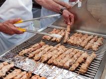 Greek cuisine: Cooking kebabs Stock Images