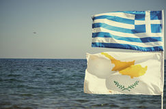 Greek and Cypriot flags on the background of the sea Royalty Free Stock Image