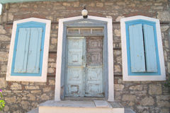 Greek door. Greek front door, with the classic faded blue color Royalty Free Stock Photography
