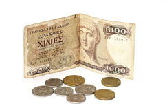 Greek drachma and coins Royalty Free Stock Image