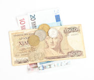 Greek drachma and coins and euro banknotes Royalty Free Stock Photos