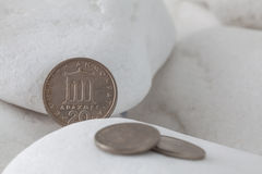 Greek drachma coins on a white stones Stock Photo