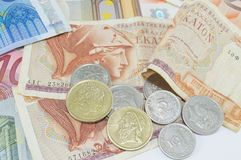 Greek drachma and euro banknotes on white Stock Images