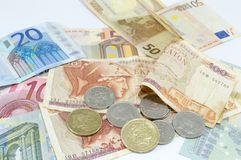 Greek drachma and euro banknotes on white Stock Image