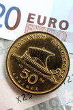 Greek drachma on euros vertical Royalty Free Stock Images
