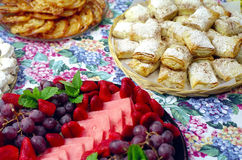 Greek Easter Food. Baking and fruit trays decorate a Greek holiday table Stock Photography