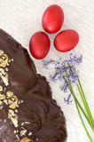 Greek Easter bread , tsoureki covered with chocolate and red egg Stock Photo