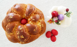 Greek Easter bread, tsoureki and red eggs Royalty Free Stock Images