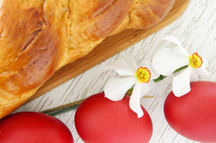 Greek Easter bread, tsoureki and red eggs Stock Images