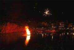 Greek Easter in Crete in Agios Nikolaos. Easter Night at Voulismeni Lake. Royalty Free Stock Photo
