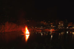 Greek Easter in Crete in Agios Nikolaos. Easter Night at Voulismeni Lake. Royalty Free Stock Images