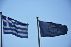 Greek and EU flags flying together side by side Royalty Free Stock Photos