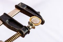 Greek Euro coin squezzed in clamp. Royalty Free Stock Photo