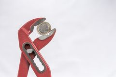 Greek Euro coin squezzed with pliers. Stock Image