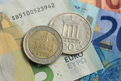 Greek and euro money. Greek Drachma and euro coin on bank note Stock Image