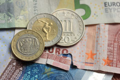 Greek and euro money. Old Greek and modern greek euro coins on Euro bank notes Stock Photography