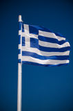 Greek falg. Greek national flag in the wind, on a blue deep sky Royalty Free Stock Photography