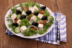 Greek farmers salad with gigantic black olives, sheeps cheese Royalty Free Stock Photo