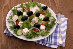 Greek farmers salad with huge black olives and sheeps cheese Stock Images