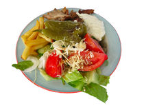 Greek fast food - fish, broccoli, mushrooms on plate Stock Photos