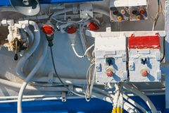 Greek Ferry Docking Control. Greek ferryboat operating system for docking the stern hatch car ramp with old hydraulic lever and emergency button. Painted Over stock photography