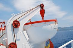 Greek ferry lifeboat. A lifeboat and winch on a Greek ferry crossing the Aegean sea near Skiathos island Stock Images