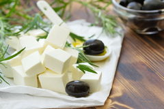 Greek feta cheese with black olives Stock Photos