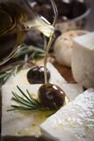 Greek feta cheese. Famous dairy product with black olives and rosemary Stock Photography