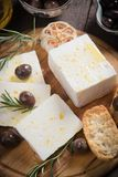 Greek feta cheese. Famous dairy product with black olives and rosemary Royalty Free Stock Photos