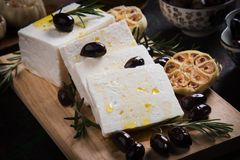 Greek feta cheese. Famous dairy product with black olives and rosemary Stock Photo