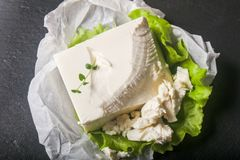 Greek feta cheese. With salad leaves and thyme branch Royalty Free Stock Images