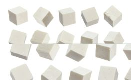 Greek feta cubes. Diced soft cheese isolated on white background Stock Image