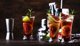 Free Greek Fig Tree Alcoholic Cocktail With Cognac, Liquor, Lime Juice, Figs And Honey, Old Wooden Table, Bar Tools Stock Images - 156948854