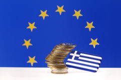 Greek financial crisis. Greek flag and currency of the European Union flag in the background Stock Photography
