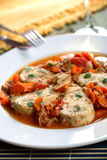 Greek fish. Stewed greek fish with carrot and garlic Stock Image
