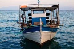 Greek Fishing Boat at Dusk Stock Photo