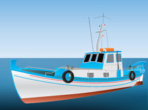 Greek Fishing Boat. A Traditional Greek Fishing Boat on a calm blue sea Stock Images