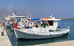 Greek Fishing Boats. Colourful Greek fishing boats moored in harbour on the island of Kos stock photography