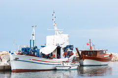 Greek fishing boats and fishermans Stock Photography
