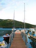 Greek fishing boats in marina. Fishing boats and sailboats moored in a marina in Greece Royalty Free Stock Image
