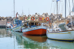 Greek fishing boats stay parked at port of Ierapetra town Stock Photo