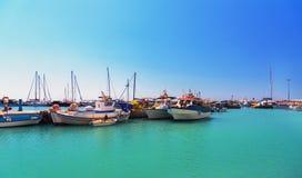 Greek Fishing Boats Stays Parked Near Sea Pier At Vlychada Town At Santorini Island, Greece Stock Photo