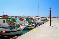 Greek fishing boats stays parked near sea pier at Vlychada town at Santorini island Stock Photography