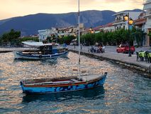 Greek Fishing Boats in Village Harbour Stock Images