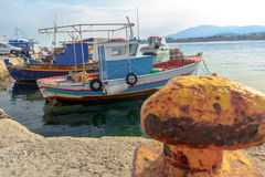 Greek fishing moored motor boats floating near concrete Mastihari bay on Greek Kos island Stock Image