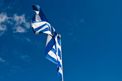 Blue and white Greek flag against blue sky, holida. Waving flag of Greece on Skiathos Island stock photography