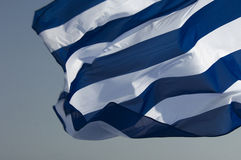 Greek Flag. A greek flag with blue & white stripes fluttering with the wind Royalty Free Stock Photography