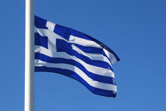 Greek flag. White-blue greek flag on clear blue sky royalty free stock photos